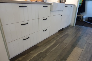 White cabinet doors accentuated with dark handles