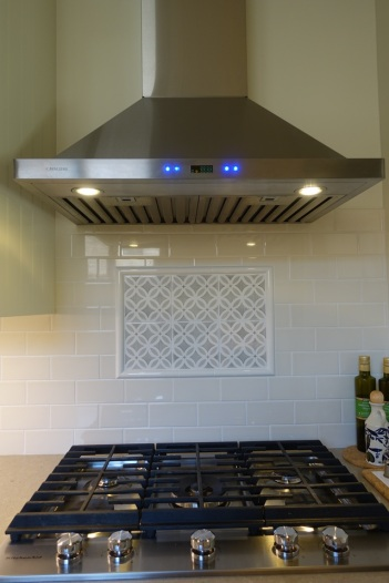 Stove top and hood with custom tiles